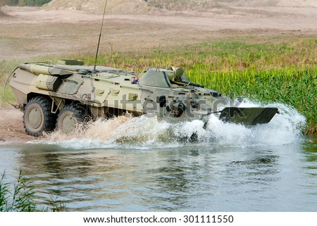 Rovno, Ukraine - 23 September 2011. APC BTR-80 enters the water, for crossing the river.
