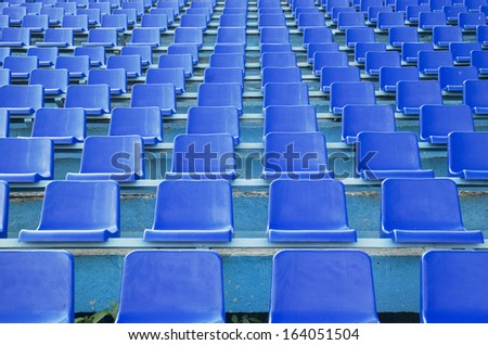 row an empty blue seats - stock photo