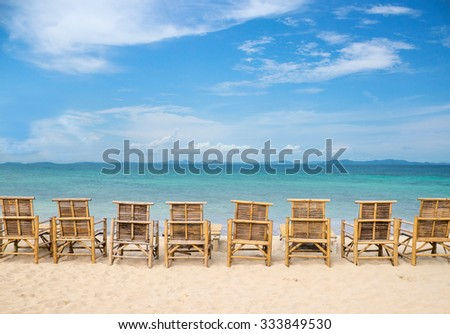 row bamboo beach chair with blue sky and sea view.at Koh Chang Island.Vacation and Tourism concept.Thailand Sea
