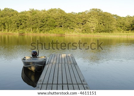Row Boat and Dock - stock photo