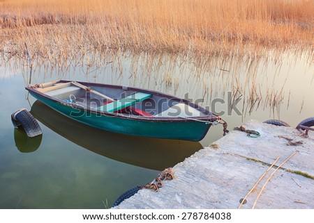 Row boat at beautiful sunset - stock photo