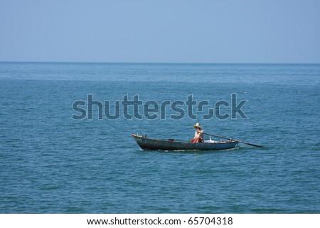 Row Boat at sea - stock photo
