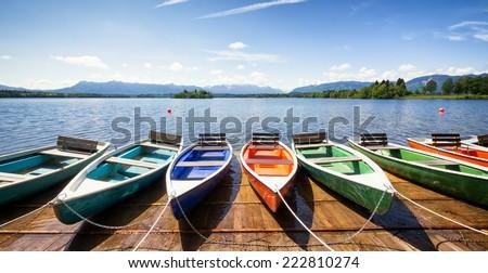 row boats at a lake - stock photo