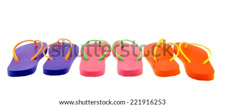 Row colorful flip flops isolated over white background