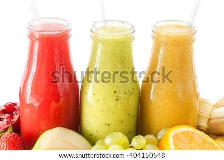 Row Fresh Juices Smoothie Three Bottles Red Green Orange Fruits Vitamins Healthy Concept isolated on white - stock photo