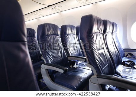 Row of Airplane Seat and windows Flight