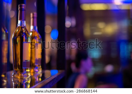 row of alcohol bottle on wooden shelf in fine dining restaurant - stock photo