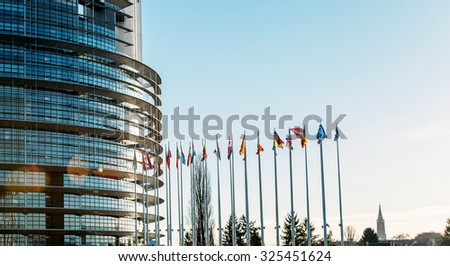 Row of all European Union Flags in Strasbourg, France at the European parliament on a clear sky day - stock photo