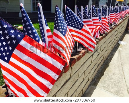 Row of American flags displayed on the street in celebration of Independence Day  - stock photo