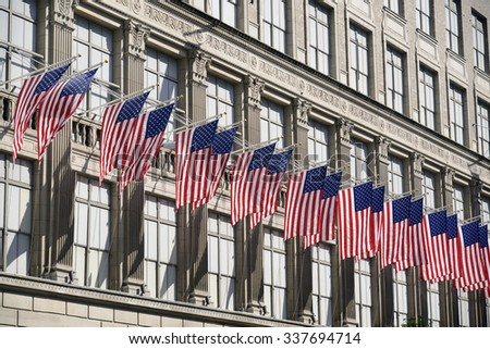 Row of American flags in an impressive building in the center of New York. - stock photo