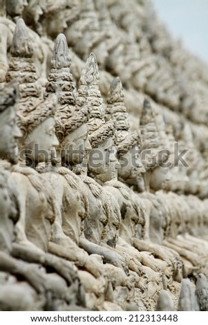 Row of Angel statue on the temple fence in Thailand - stock photo