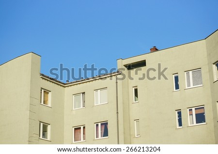Row of apartment buildings on a sunny day