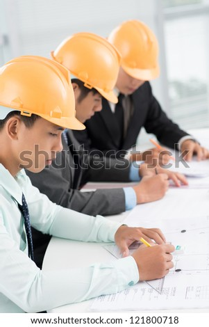 Row of architect being busy projecting - stock photo