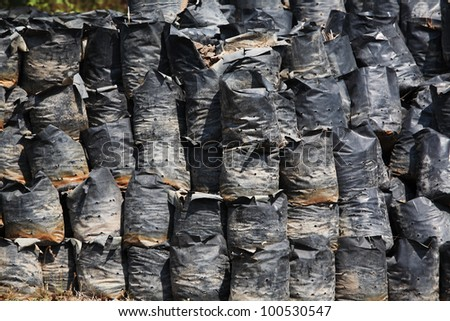 row of ash bags