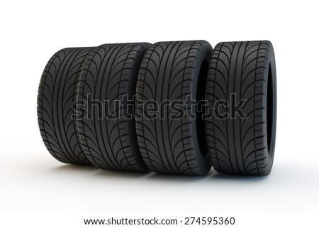 row of automobile tires among with the central wheels pushed forward - stock photo