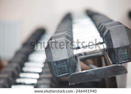 Row of barbells in gym room. Horizontal photo - stock photo