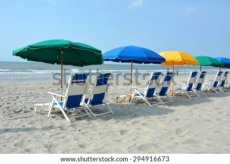Row of beach chairs and umbrellas on the beach