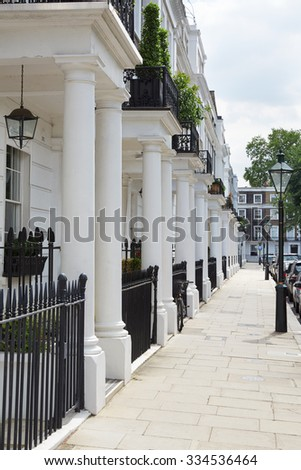 Row of beautiful white edwardian houses in Kensington, London  - stock photo
