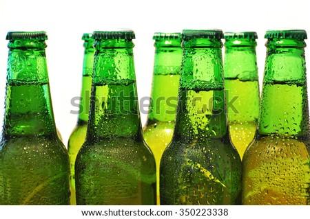 Row of beer bottles - stock photo