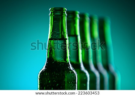 Row of beer bottles with waterdrops