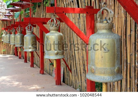 Row of bells in a buddhist temple of Thailand - stock photo