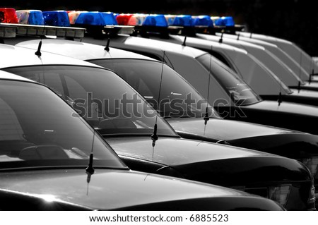 Row of Black and White Police Cars with Blue and Red Lights - stock photo