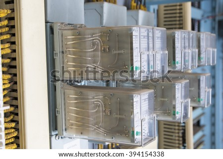 Row of  blue and yellow Relay actuators
