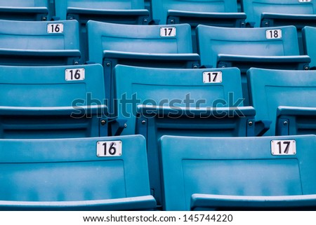 row of blue chairs in a stadium - stock photo