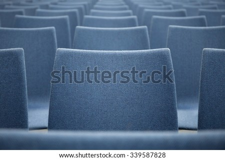 Row of blue chairs inside the conference hall. Abstract