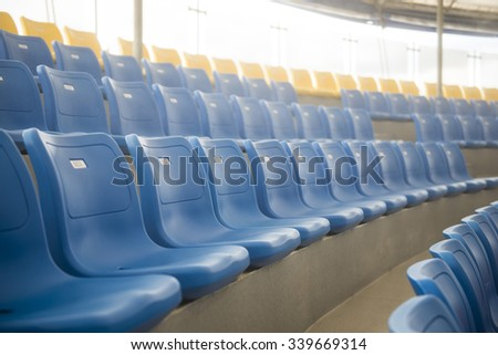 row of blue plastic chairs on the stadium, seat