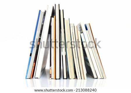 Row of books on white background - stock photo
