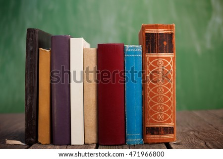 Row of books on wooden table