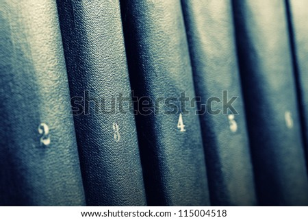 Row of books. Toned in blue - stock photo