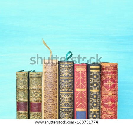 row of books with bookmarks, free copy space  - stock photo