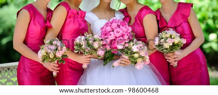 Row of bridesmaids with flowers - stock photo