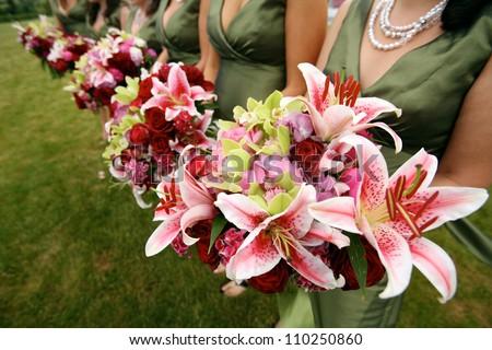 Row of Bridesmaids with Iris Wedding Bouquets - stock photo