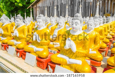 Row of Buddha statues at Myanmar Temple, Southeast Asia - stock photo