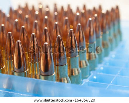 Row of bullets in the box. - stock photo