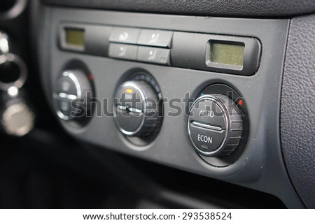 Row of buttons of a car airco - stock photo