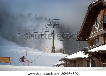 Row of cable cars on highland ski resort at Austrian Alps - stock photo