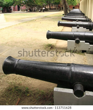 Row of cannons at Fort Jesus Mombasa Kenya - stock photo