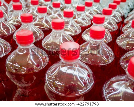 row of carbonated soft drink bottles