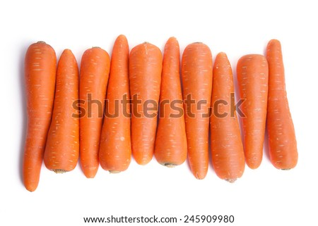 row of carrots on white background - stock photo