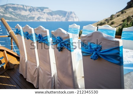 Row of chairs decorated for a part event - stock photo