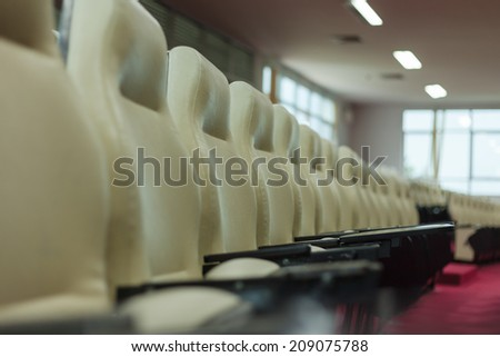 Row of chairs in conference room - stock photo