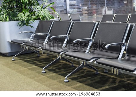 Row of Chairs Inside Waiting Room at Airport