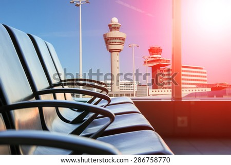 Row of chairs to hall in the airport - stock photo