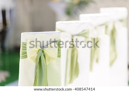 row of chairs with green ribbon - stock photo