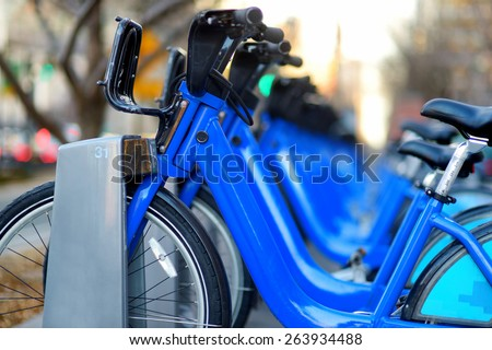 Row of city bikes for rent at docking stations in New York, USA