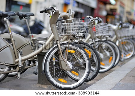 Row of city bikes for rent in Paris, France - stock photo